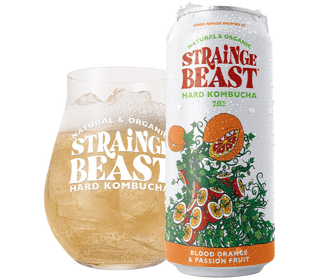 Can and glass of Strainge Beast Blood Orange & Passion Fruit