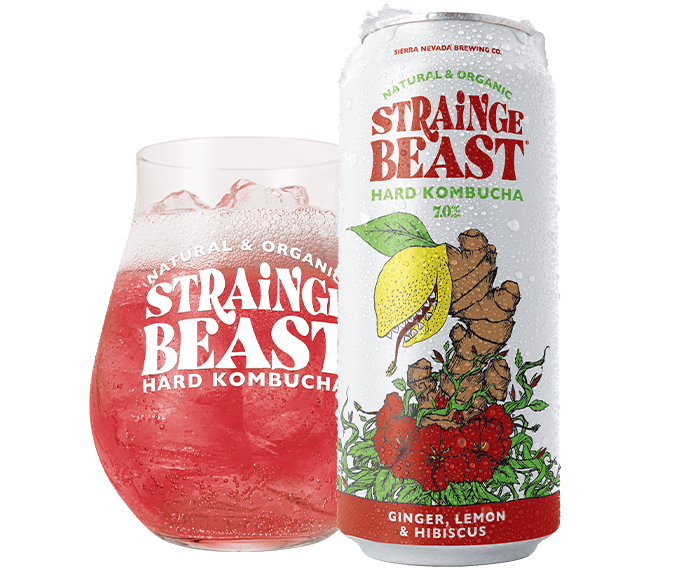 Can and glass of Strainge Beast Ginger, Lemon & Hibiscus
