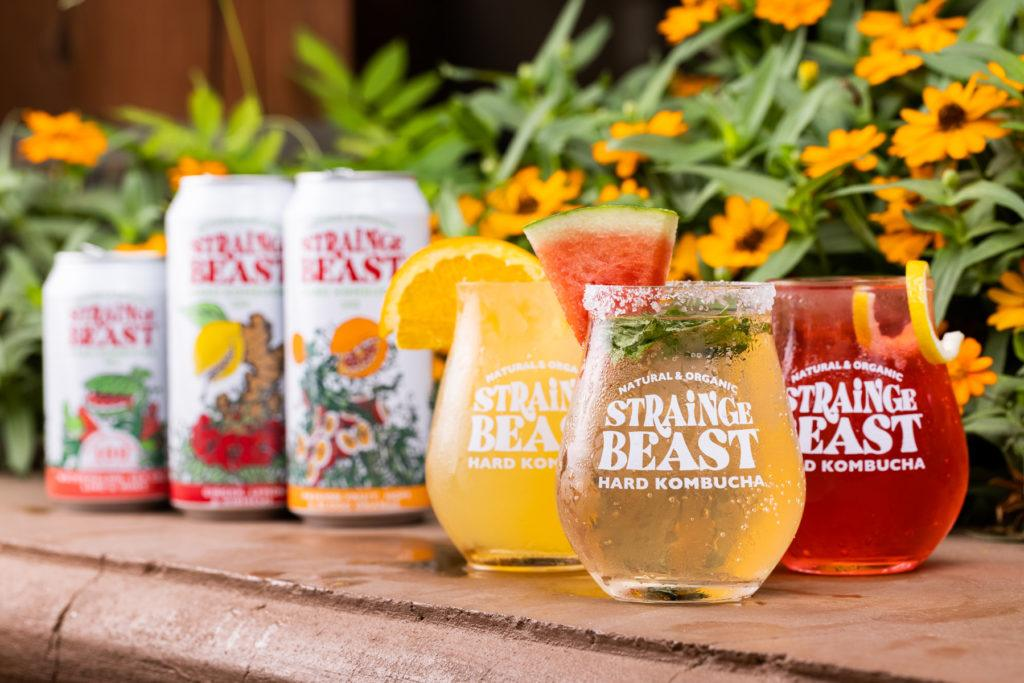 Three Strainge Beast flavors in glasses topped with garnishes